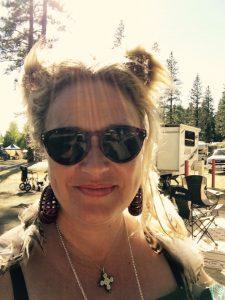 Shiloh at festival wtih earrings